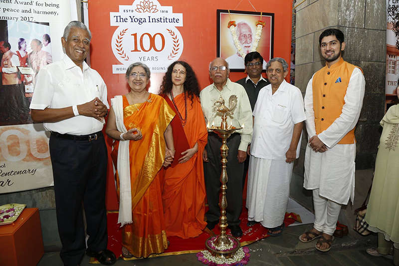Smt. Hansaji lighting the lamp with Hrishiji.