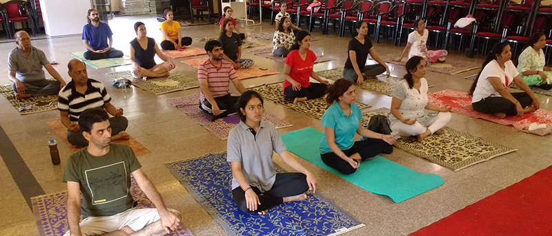 Students attentively listening to instructions for asanas.