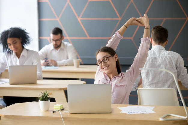 employee stretching break from office
